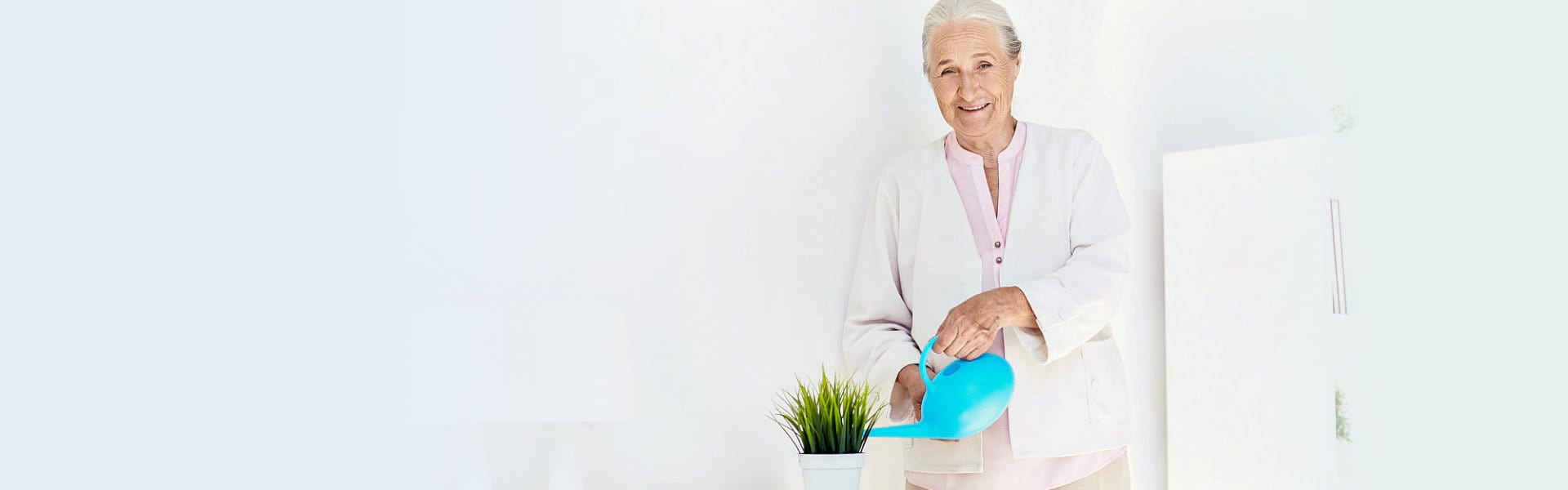 senior woman watering plants