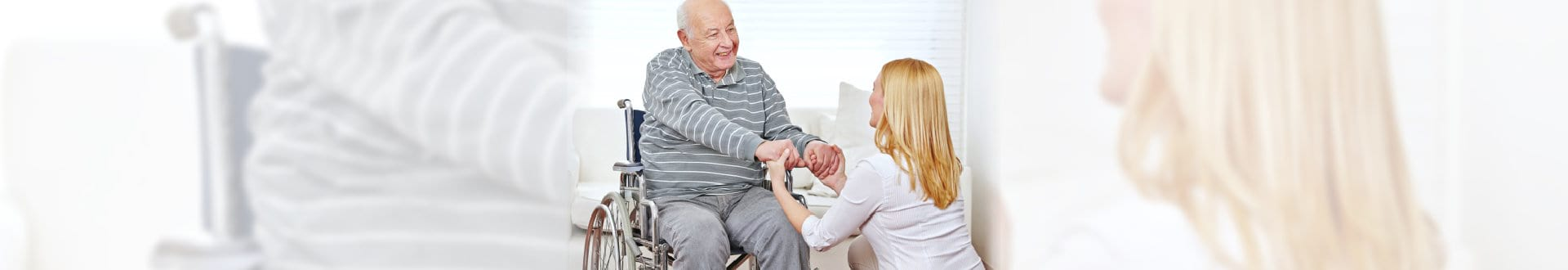 caregiver and senior man holding hands