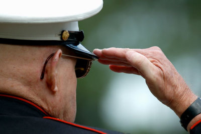 veteran man saluting