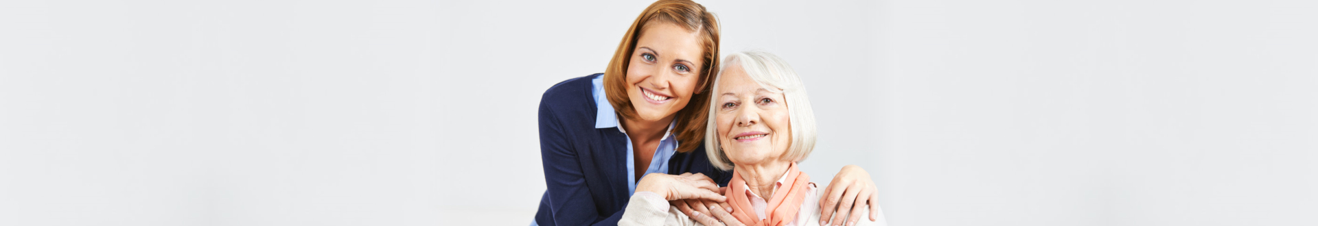 portrait of senior woman and caregiver
