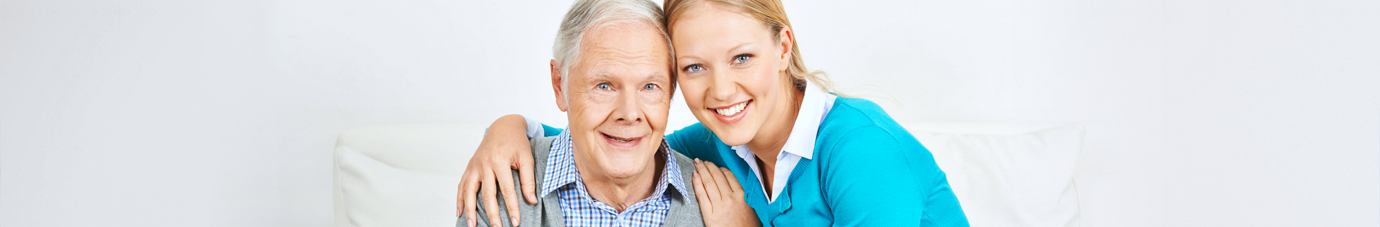 portrait of senior man and caregiver